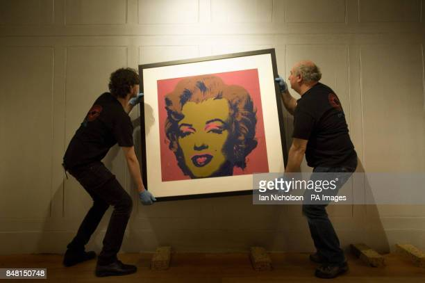 A silk screen print of Marilyn Monroe by Andy Warhol is hung at the Dulwich Picture Gallery ahead of a major new exhibition of the US artist's work