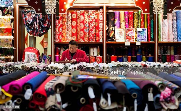 silk shop seller - peking stockfoto's en -beelden