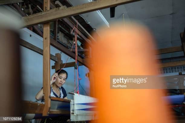 Silk weaving process at the Mai Savanh Lao workshop in Vientiane Laos on December 10 2018