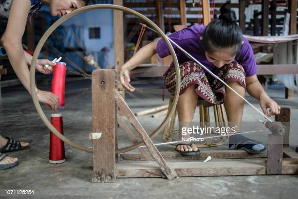 Silk weaving process at the Mai Savanh Lao workshop in Vientiane Laos on December 10 2018