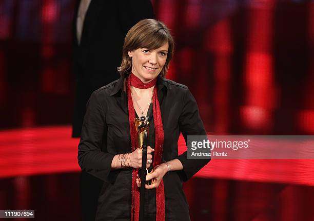 Silke Buhr receives the Lola for Best Production Design during the German Film Award 2011 at Friedrichstadtpalast on April 8 2011 in Berlin Germany