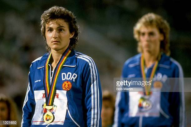 Silke Gladisch of East Germany stands on the winners'' podium after her victory in the 100 metres event during the World Championships at the Olympic...