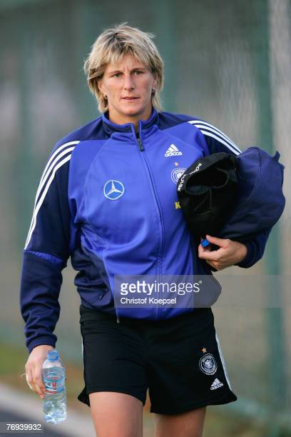 Silke Rottenberg looks on during the Women's German National Team training session on the training ground at the Wuhan Sports Center Stadium on...