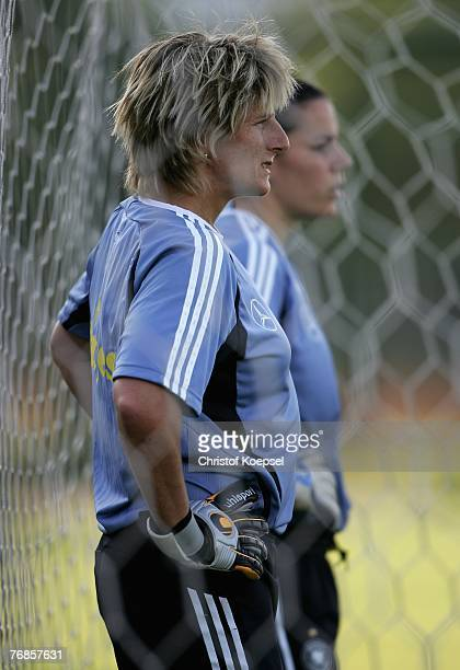 Silke Rottenberg looks thoughtful during the Women's German National Team training session on the training ground at the Wuhan Sports Center Stadium...
