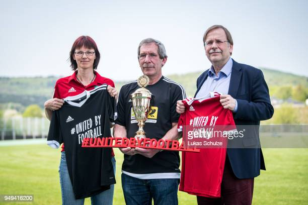 Silke Sinning and DFB Vice President Dr Rainer Koch honor amateur Of the Year Hanno Makel on April 21 2018 in Weilburg Germany
