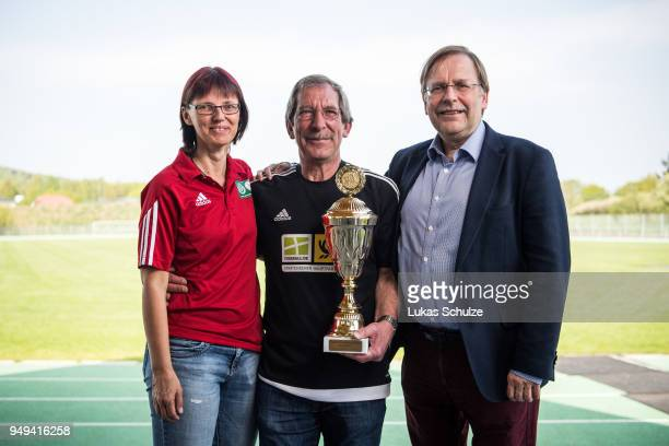 Silke Sinning and DFB Vice President Dr. Rainer Koch honor amateur Of the Year Hanno Makel on April 21, 2018 in Weilburg, Germany.