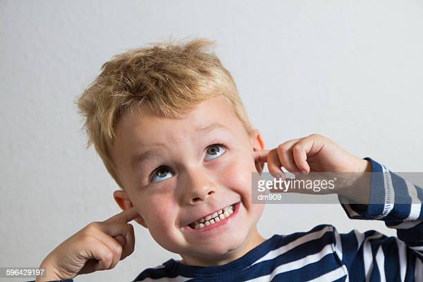 silly boy! - fingers in ears stock pictures, royalty-free photos & images