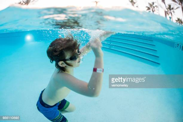 Silly child playing underwater