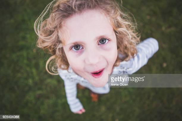 Silly girl looking up at camera