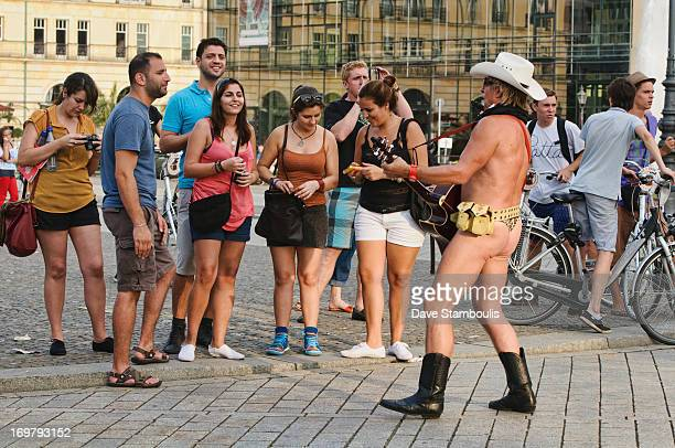 CONTENT] Silly guitarist in a g string at the Brandenburg Gate in Berlin Germany