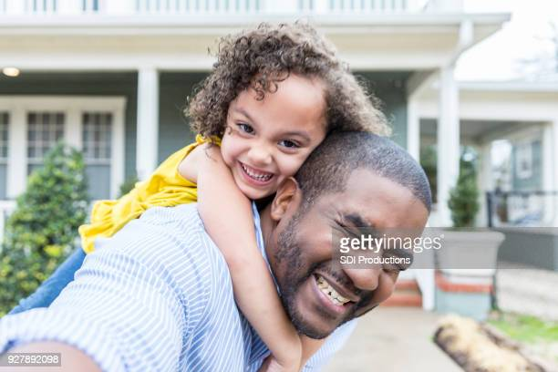 silly piggyback selfie of father and young daughter - funny black girl stock photos and pictures