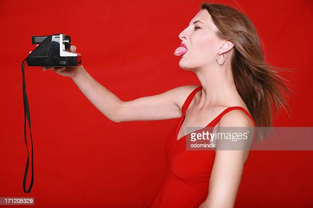 silly self portrait - woman long tongue stock photos and pictures