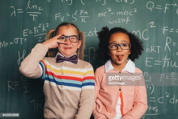 silly young retro nerd girls in classroom - comedian stock pictures, royalty-free photos & images