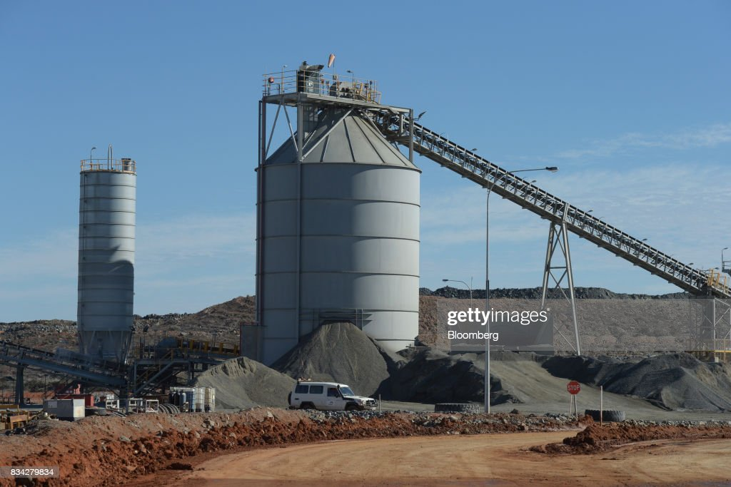 A silo stands at the processing plant of Evolution Mining Ltd.'s gold operations in Mungari, Australia, on Tuesday, Aug. 8, 2017. Evolution Mining is Australias second-largest gold producer. Photographer: Carla Gottgens/Bloomberg via Getty Images