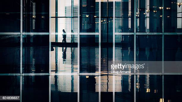 Silohuette of businessman through office window