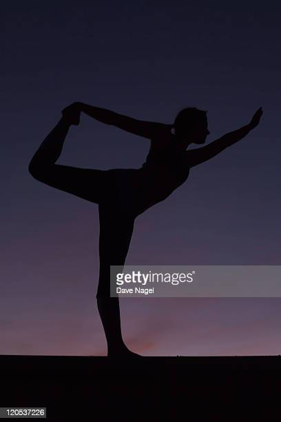 silohuette of girl doing yoga.