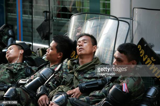 Silom Road, Bangkok, Thailand, police officers taking a nap while waiting for orders.jpg