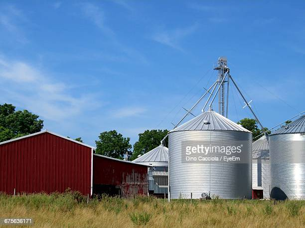silos and barn against sky - silo stock photos and pictures