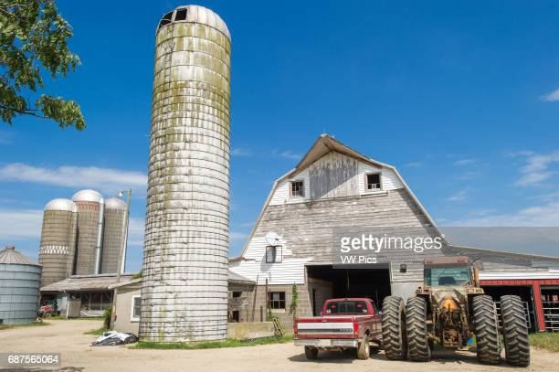 Silos and wooden barn needing paint in Ridgley Maryland USA