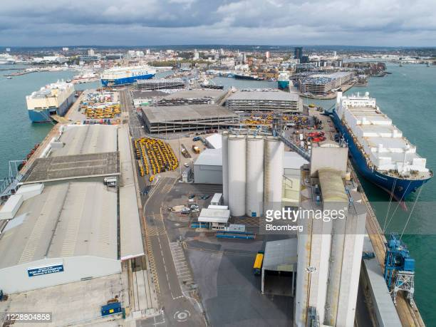Silos stand at the Grain Terminal at the Port of Southampton, operated by Associated British Ports Holdings Ltd., in this aerial view in Southampton,...