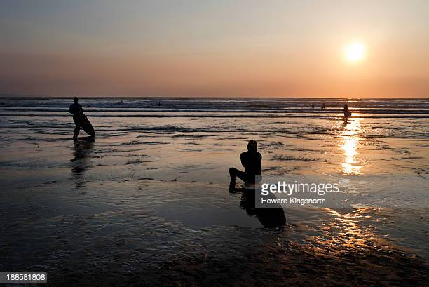 Silouette of surfers at sunset
