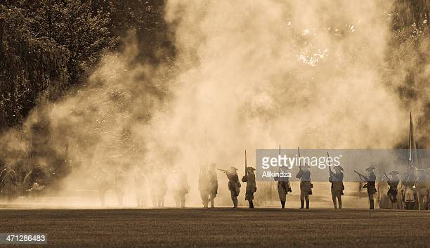 silouettes in cannon smoke ii - cannon stock pictures, royalty-free photos & images