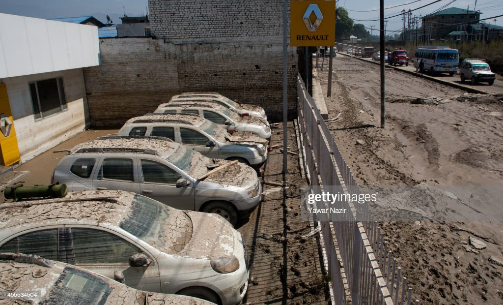Silt covered cars sit in a dealership after the flood waters receded on September 16, 2014 in Srinagar, the summer capital of Indian administered Kashmir, India. Nearly 200,000 people are still marooned in the areas of the Kashmir Valley submerged in flood waters. The floods in the Himalayan region of Kashmir were believed to be the worst in decades with over 200 dead. Health experts are worried over the stagnant waters and floating carcasses of livestock could create conditions for serious outbreaks of disease.