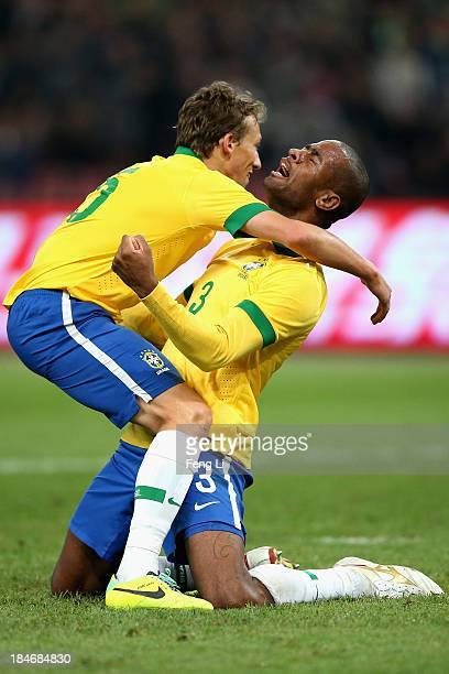 Silva Anderson of Brazil celebrates a goal with his teammate Leiva Lucas during the international friendly match between Brazil and Zambia at Beijing...