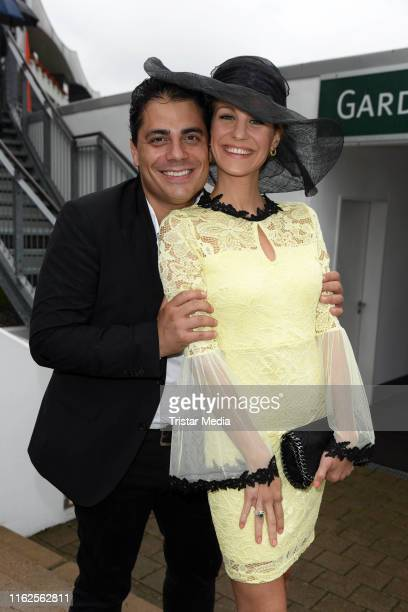 Silva Gonzalez of the band Hot Banditoz and his girlfriend Stefanie Schanzleh attend the Audi Ascot Race Day at Neue Bult horse racing track on...