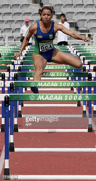 Silva Lucimara Silvestre of Brazil races during the women's 100 meter hurdles at the First Lusofonia Games in Macau 12 October 2006 Silvestre clocked...
