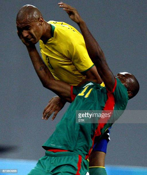 Silva Thiago of Brazil heads the ball with Gustave Bebbe of Cameroon during their men's quarterfinals football match at the Beijing 2008 Olympic...