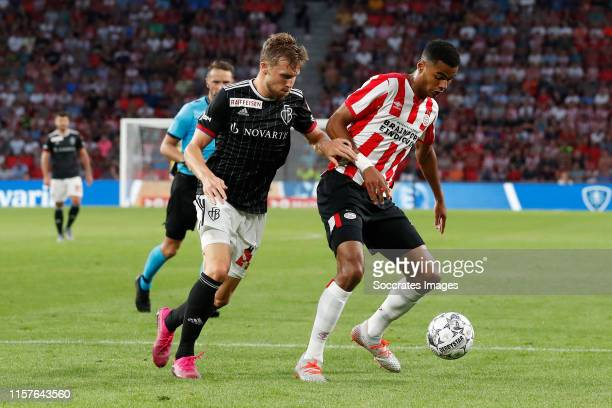 Silvan Widmer of FC Basel, Cody Gakpo of PSV during the UEFA Champions League match between PSV v Fc Basel at the Philips Stadium on July 23, 2019 in...