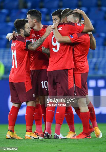 Silvan Widmer of Switzerland celebrates his team's first goal with teammates during the UEFA Nations League group stage match between Switzerland and...