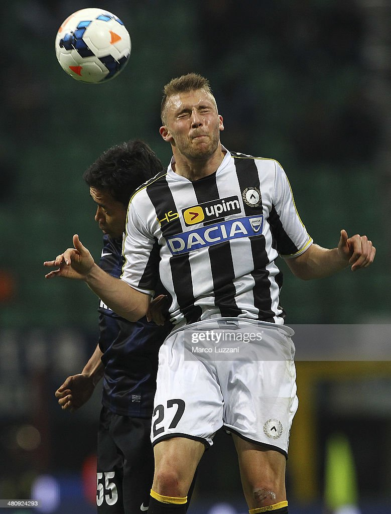 Silvan Widmer (R) of Udinese Calcio competes for the ball with Yuto Nagatomo (L) of FC Internazionale Milano during the Serie A match between FC Internazionale Milano and Udinese Calcio at San Siro Stadium on March 27, 2014 in Milan, Italy.