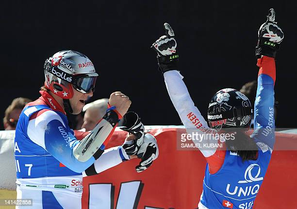 Silvan Zurbriggen and Wendy Holdener of Switzerland celebrate their second place during National team event at the Alpine ski World Cup finals on...