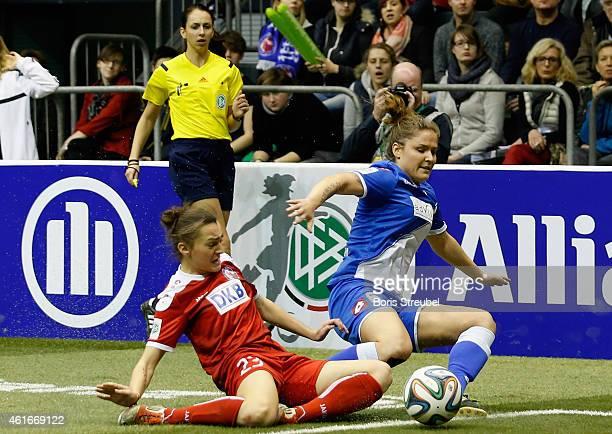 Silvana Chojnowski of TSG 1899 Hoffenheim is tackled by Lidija Kulis of Turbine Potsdam during the DFB Women's Indoor Football Cup 2015 match between...