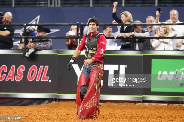 Silvano Alves celebrates following his ride of bull Short Night during the PBR World Finals, on November 15th at the AT&T Stadium, Arlington, TX.