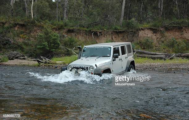 silver 2007 jeep jk wrangler rubicon river crossing - jeep wrangler stock photos and pictures