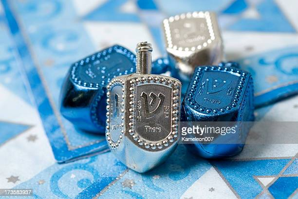 silver and blue dreidels - dreidel stock photos and pictures