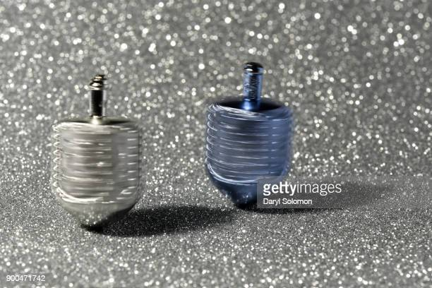 Silver and Blue spinning dreidels
