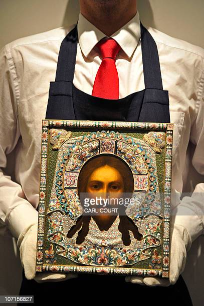 A silver and enamel icon of the Mandylion Orest Kurlyukov Moscow is pictured at Sotheby's auction house in London on November 26 2010 The icon valued...