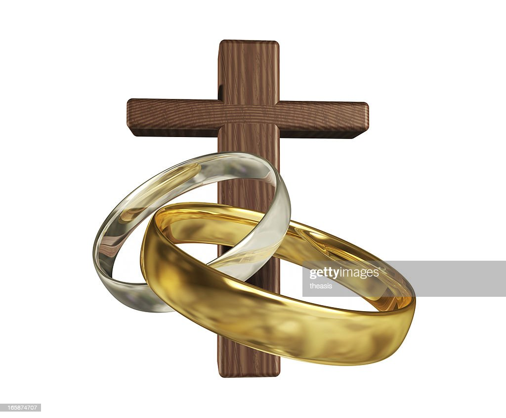 Silver And Gold Wedding Rings With A Wooden Cross. : Stock Photo