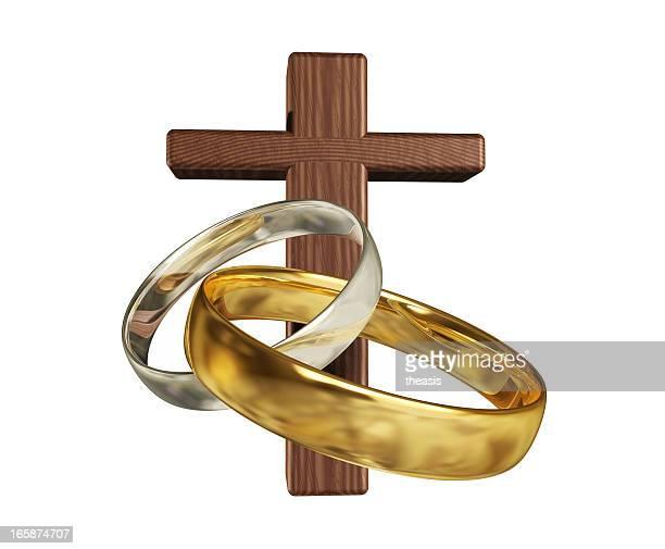 silver and gold wedding rings with a wooden cross. - theasis bildbanksfoton och bilder
