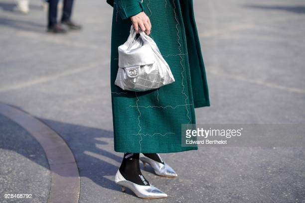 A silver bag and silver shoes outside Chanel during Paris Fashion Week Womenswear Fall/Winter 2018/2019 on March 6 2018 in Paris France