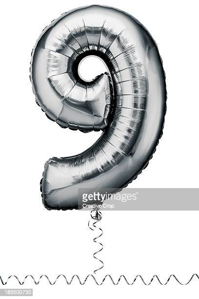 Silver balloon in the shape of a number nine