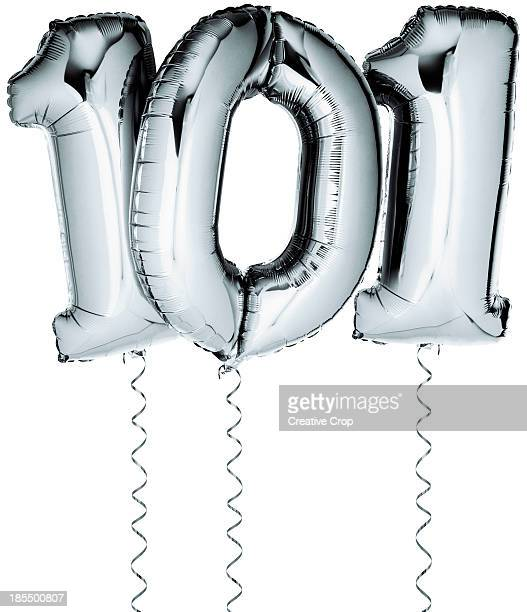 Silver balloons in the shape of a number 101
