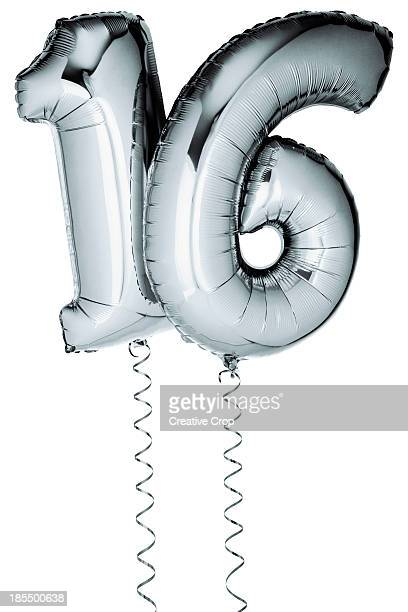Silver balloons in the shape of a number 16