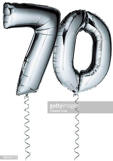 Silver balloons in the shape of a number 70