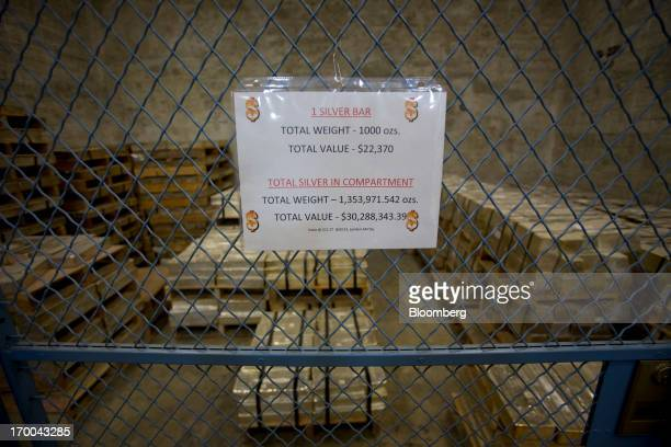 Silver bars sit in a vault at the United States Mint at West Point in West Point New York US on Wednesday June 5 2013 Sales of gold and silver coins...