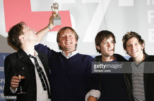 Silver Bear winner Director David Mackenzie holds up his award from left Alex Kapranos Jamie Bell and Nick McCarthy